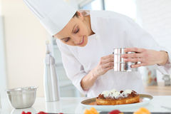 Pastry chef making a cake Royalty Free Stock Photo
