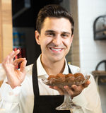 Pastry chef offering chocolate truffles Royalty Free Stock Photos