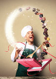 Pastry chef packages the chocolates Royalty Free Stock Photos
