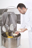 Pastry Chef prepares the ingredients. Pastry Chef pours ingredients into the mixer Stock Images