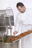 Pastry Chef prepares the ingredients. Pastry Chef pours ingredients into the mixer Stock Photos