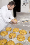 Pastry Chef prepares the ingredients. Pastry Chef, prepares dough to make the cake panettone Royalty Free Stock Image