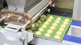 Pastry chef prepares the puffs with portioning machine. Industrial pastry chef prepares the puffs with portioning machine stock footage