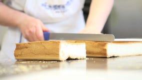 Pastry chef prepares the sponge cake stock video footage