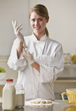 Pastry Chef Putting On Gloves Stock Images