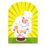 Pastry Chef Putting Icing On Cake Royalty Free Stock Photography