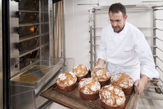 Pastry Chef, takes away the panettone. From the oven freshly cooked Royalty Free Stock Image