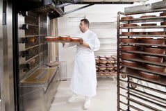 Pastry Chef, takes away the panettone. From the oven freshly cooked Royalty Free Stock Photography