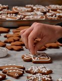 Fresh christmas cookies preparation hands. Stock Images
