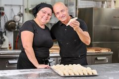 Pastry chefs making delicious croissants in the pastry shop kitchen. royalty free stock image
