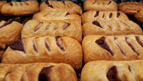 Pastry with cherry on tray Stock Photography