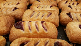 Pastry with cherry on tray Royalty Free Stock Images