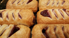 Pastry with cherry on tray Royalty Free Stock Photography