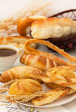 Pastry with coffee Stock Images