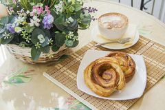 Pastry with coffee in Typical parisian cafe Royalty Free Stock Images