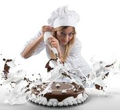 Pastry cook prepares a cake. With cream and chocolate Royalty Free Stock Image