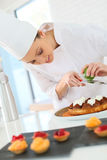 Pastry cook preparing a cake Stock Images