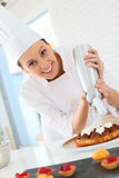 Pastry cook preparing a chocolate cake Stock Photo