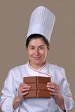 Pastry cook woman beaking chocolate Royalty Free Stock Image
