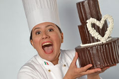 Pastry cook woman holding chocolate cake. Royalty Free Stock Photography
