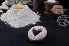 Pastry cookie with a red jam heart and icing powder sugar Stock Photography