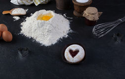 Pastry cookie with a red jam heart and icing powder sugar Royalty Free Stock Photography