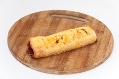 Pastry with corn flour and topped with peppers Stock Image