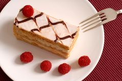 Pastry cream Napoleon with raspberries. On white plate Royalty Free Stock Photography
