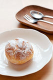 Pastry cream puffs. Choux pastry cream puffs on white plate Royalty Free Stock Photos