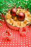 Pastry cutters and christmas balls Stock Image