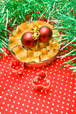 Pastry cutters and christmas balls Stock Photos