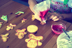 Pastry decorating Christmas cookies royalty free stock images