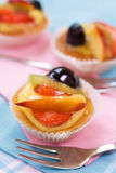 Pastry with fruit. Sweet pastries with fruit and a fork stock photography