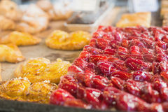 Pastry with fruit on counter Royalty Free Stock Image
