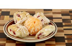 Pastry and Fruit on a serving plate. On a cutting board stock photo