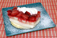 Pastry with fruit and whipped cream. Stock Image