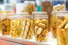 Pastry in glass jars closeup, bakery case stock photos