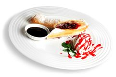 Pastry with ice cream and souce on white plate. Pastry cream ice souce red white background stock photos