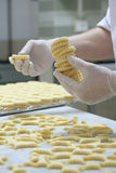 Pastry making biscuit. S with white gloves Royalty Free Stock Photography