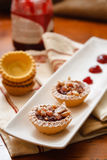 Pastry mignon with cream. And decoration with curl stock images