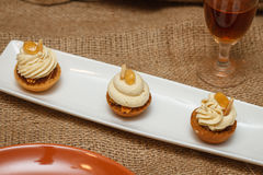 Pastry mignon with cream. And decoration with curl royalty free stock image