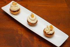 Pastry mignon with cream. And decoration with curl stock photo