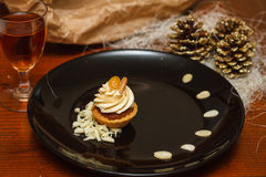 Pastry mignon with cream. And decoration with curl stock photography
