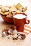 Pastry with milk for breakfast. Cup with coffee cup filled with cookies on a wooden countertop pine Royalty Free Stock Images