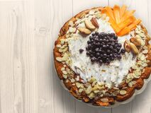 Pastry With Nuts Sliced Mangoes and Blackberries on Top Stock Images