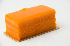 Pastry Orange cake on a white background. Stock Photo