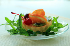 Pastry with orange and mint Royalty Free Stock Image