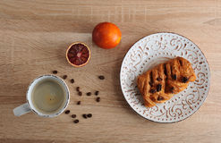 Pastry with pecan nuts on a plate with a Cup of coffee Stock Images