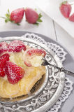Pastry pie with strawberries and custard on silver plate Stock Photography