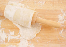 Pastry and rolling pin Stock Image